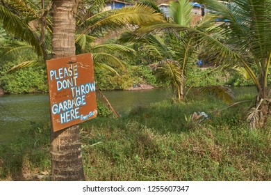 A sign against littering near a lake in Goa, India.