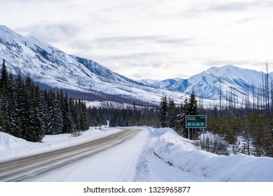 Sign along Highway 93 (Banff-Windermere Highway) en route to Kootenay National Park, shows drivers directions to Vermillion Crossing ahead. Taken in winter