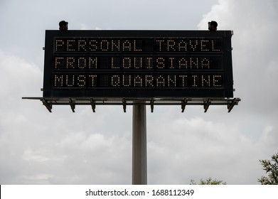 A sign along I-610 warns that Texas will enforce quarantine orders to Louisiana drivers entering state