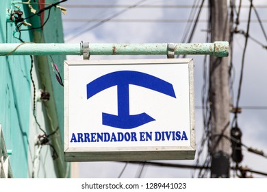 Sign 'Arrendador en Divisa' at Casa Particular (private homestay) for foreigners in Cuba. Homestays for Cubans have different color.