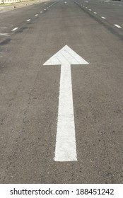 sign arrow on asphalt of road,straight go on