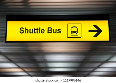 sign with arrow point to shuttle bus station at the airport for passenger who want to transfer from airport to the city. connecting transportation for convenient travel