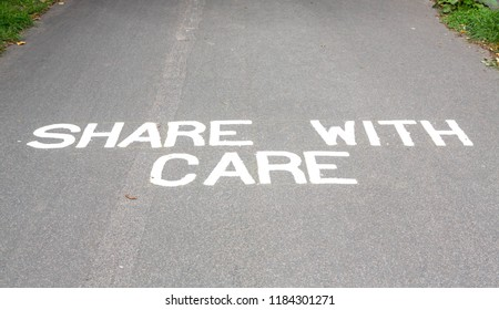 Sign asking cyclists and pedestrians to share the path with care.