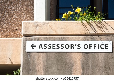 Sign for the Assessor's office on a concrete wall