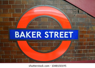 Sign of Baker Street tube station at a brick wall - London, UK - 08/02/2015