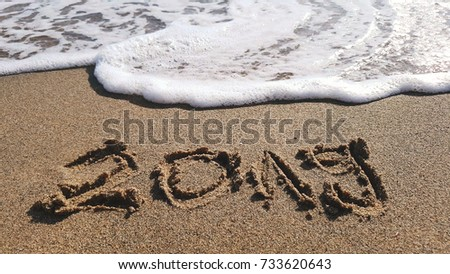 sign in beach sand saying 2019 denoting a new year