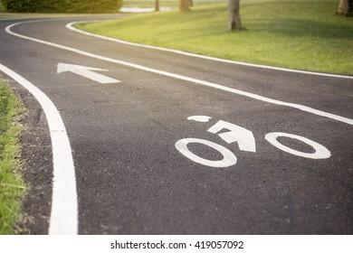 Sign of bike way on asphalt road
