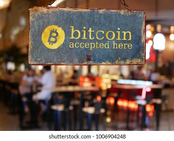 sign bitcoin accepted here hanging in front of restaurant door. bitcoin , electronic money concept