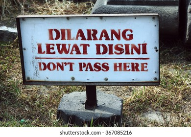 sign board of don't pass here in  Indonesian