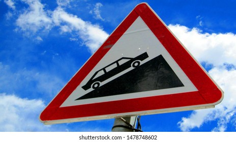A sign Board showing the road is going to steep.