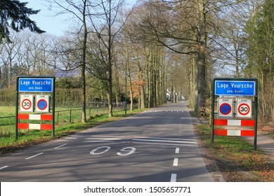 Sign board of village Lage Vuursche, community of Baarn, at forest road and 30 km speed limit, Netherlands. Here lives princess Beatrix at castle Drakensteyn
