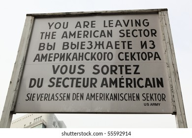 """Sign at the border crossing (""""Checkpoint Charlie"""") in Berlin, Germany"""