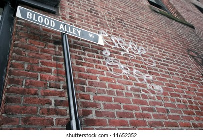 Sign by a brick wall