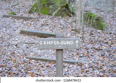sign of a campground with arrrow image.
