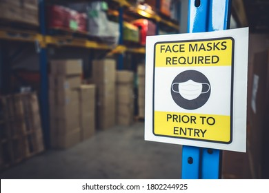 Sign caution in factory warning to industry labor worker to prevent Covid-19 Coronavirus spreading during job business reopening period after epidemic crisis . Working safely concept .