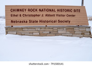 Sign for Chimney Rock National Historic Site in Bayard Nebraska, in the winter, during a snowstorm.