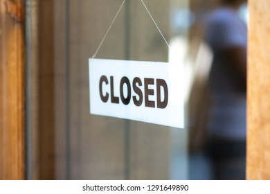 The sign is closed on door of store