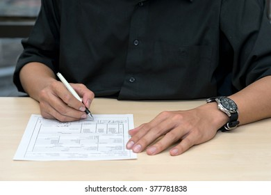 sign contract and approve document on desk