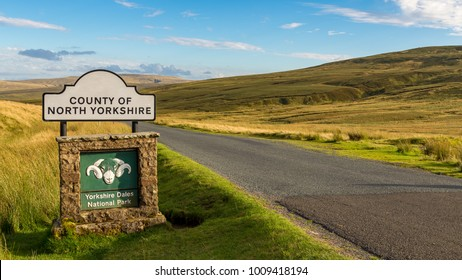 Sign: County of North Yorkshire and Yorkshire Dales National Park, seen on the B6270 road between Kirkby Stephen and Gunnerside, North Yorkshire, UK