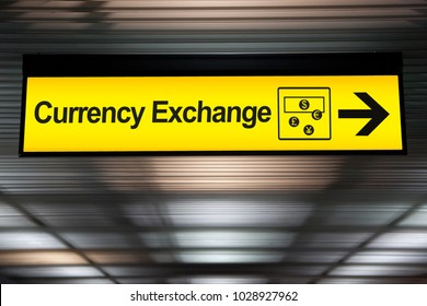sign currency exchange at the airport with money currency icon and arrow for direction to currency exchange booth counter service for tourist
