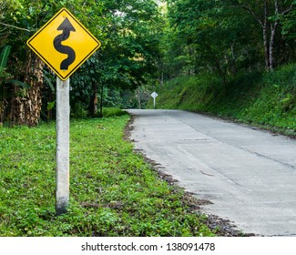 Sign curves road on the way at  the mountain