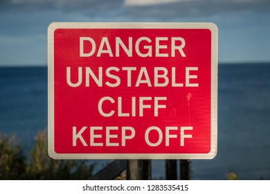 Sign: Danger unstable cliff, keep off, seen in Whitley Bay, Tyne And Wear, England, UK