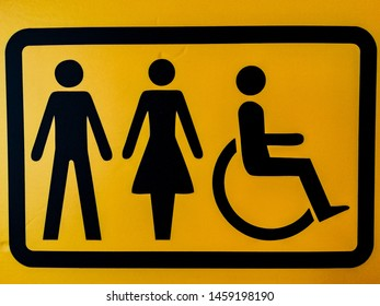 A sign depicting a man, a woman and a disabled person