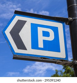 A sign directing vehicles to the nearest Car Park.