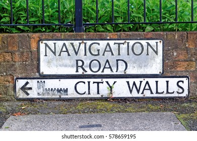 A sign directing to York City Walls on Navigation road in York, UK