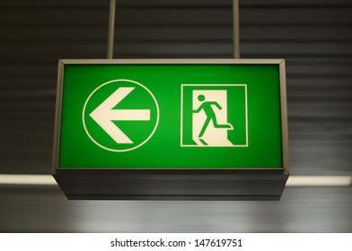 Sign with direction to emergency exit
