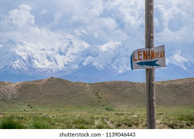 The sign with direction on famous Lenin peak in Chon-Alay valley in Pamir mountains in Kyrgyzstan near Osh in good weather. Best place for climbing, hiking and trekking.
