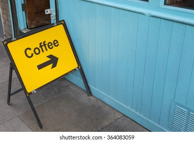A sign displaying the direction for people who need a coffee.