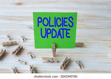 Sign displaying Policies Update. Business overview act of adding new information or guidelines formulated Piece Of Blank Square Note Surrounded By Laundry Clips Showing New Idea.