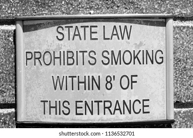 A sign displays state law