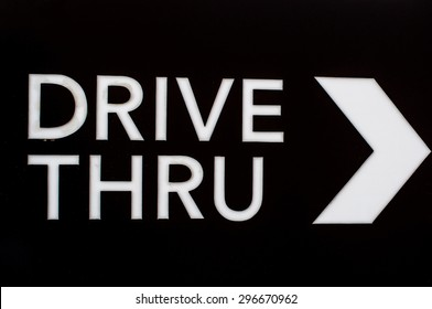 sign drive thru  on  black background.