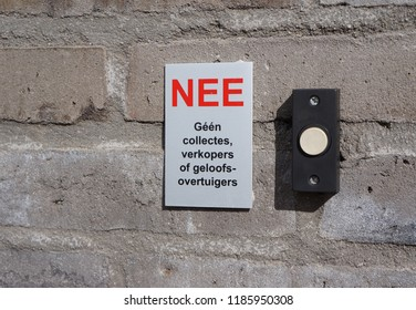 Sign in Dutch next to a doorbell warning against sales and religious people (English: no charity, sales or religion)
