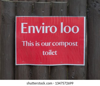 Sign for an Enviro Loo or Compost Toilet Attached to a Wooden Fence in Rural Somerset, England, UK