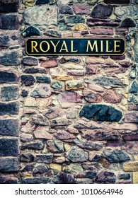 A Sign For The Famous Royal Mile On An Ancient Stone Wall In Edinburgh Scotland