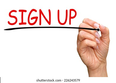 Sign up - female hand with pen on white background