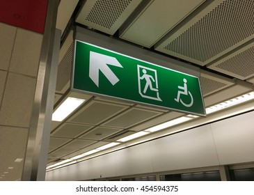 Sign of fire exit and disabled at underground railway.