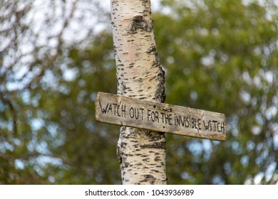 Sign found attached to a birch tree on hiking trail on Floyen mountain in Bergen, Norway. It reads Watch Out for the Invisible Witch.