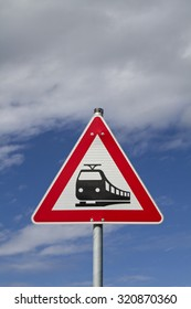 Sign in front of a railroad crossing