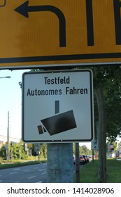 Sign in German indicating that the area is a test field for autonomous driving. The sign is located in the city of Karlsruhe. Sensors and cameras are installed in the area to support vehicles.