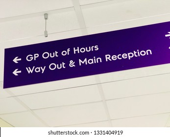 Sign for GP out of hours, way out and main reception in an NHS hospital, UK