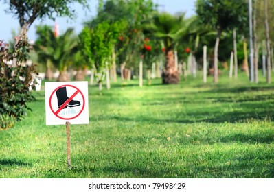 Sign with grass and blue sky