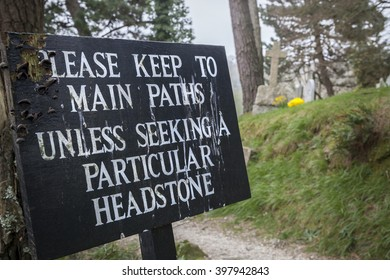 A sign at a graveyard near St Mawes across the bay from Falmouth, Cornwall, England