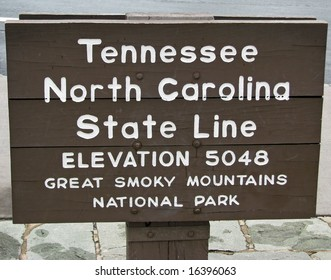 Sign in the Great Smoky Mountains indicating the North Carolina and Tennessee state lines.