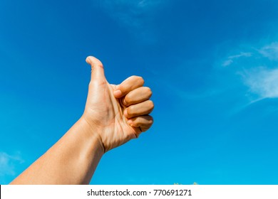 Sign of hand with blue cloudy sky background.