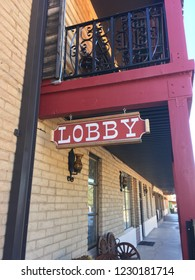 Sign hanging on Old West style building that reads:  Lobby