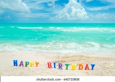 "Sign ""Happy Birthday"" on the Miami tropical beach, blue sky and ocean, Florida, USA"